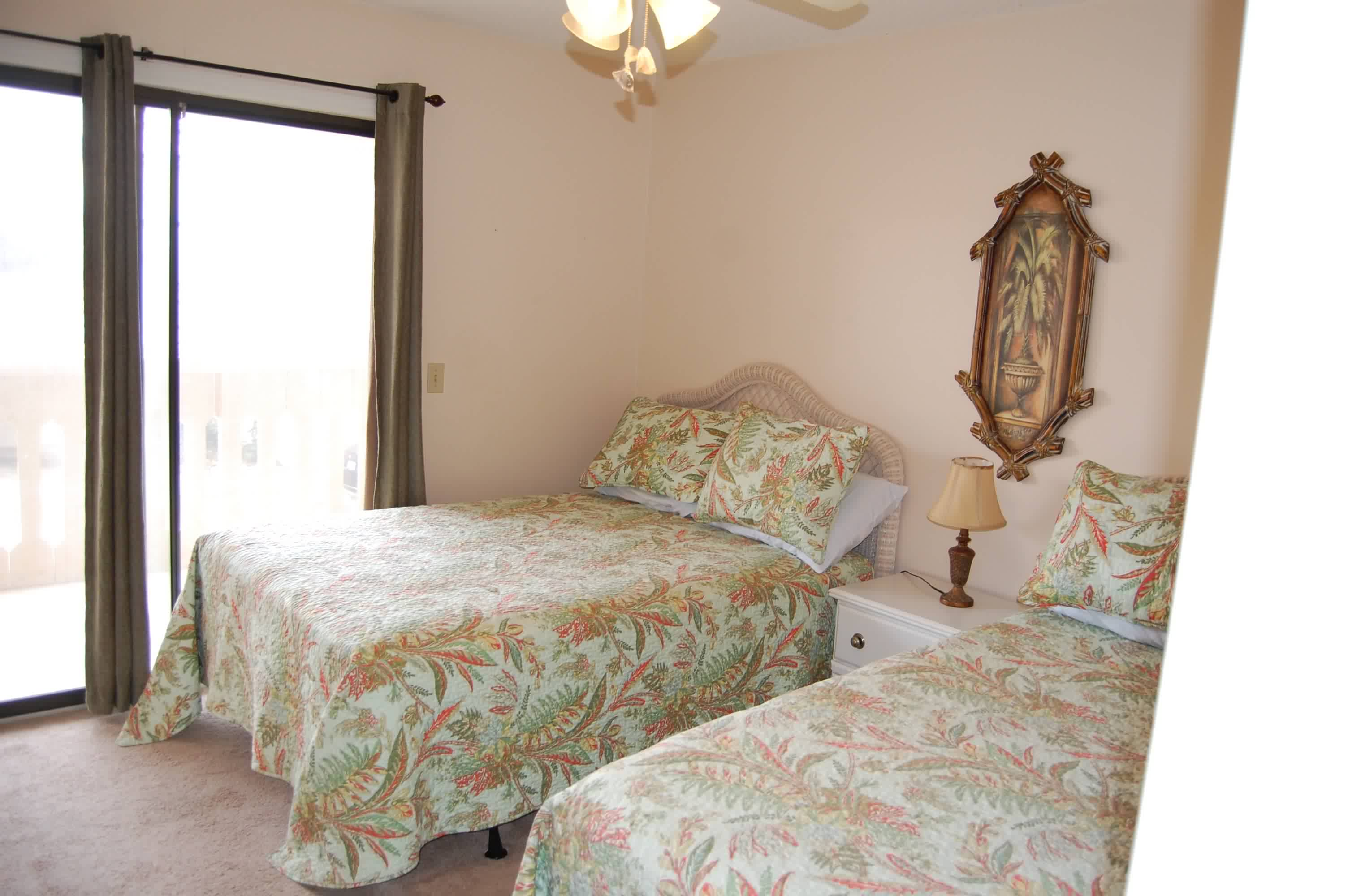 3rd bedroom with 2 full beds and adjoining balcony